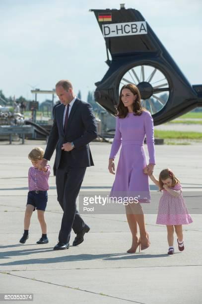 Prince William Duke of Cambridge Prince George of Cambridge Princess Charlotte of Cambridge and Catherine Duchess of Cambridge depart from Hamburg...