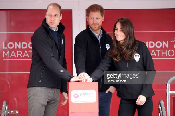 Prince William Duke of Cambridge Prince Harry and Catherine Duchess of Cambridge signal the start of the 2017 Virgin Money London Marathon on April...