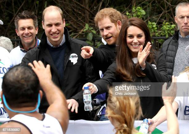 Prince William Duke of Cambridge Prince Harry and Catherine Duchess of Cambridge cheer on and hand out water to runners during the 2017 Virgin Money...