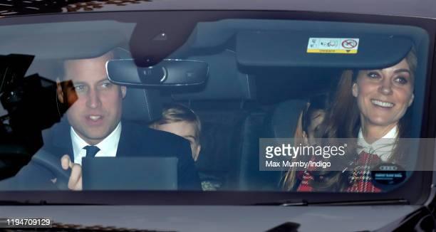 Prince William Duke of Cambridge Prince Louis of Cambridge Princess Charlotte of Cambridge and Catherine Duchess of Cambridge attend a Christmas...
