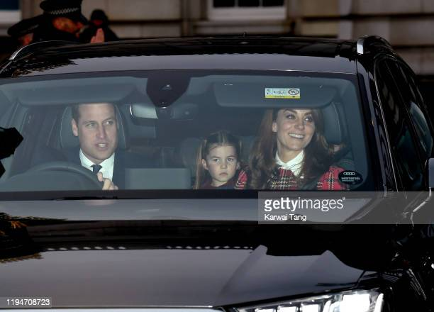 Prince William, Duke of Cambridge, Princess Charlotte and Catherine, Duchess of Cambridge attend Christmas Lunch at Buckingham Palace on December 18,...