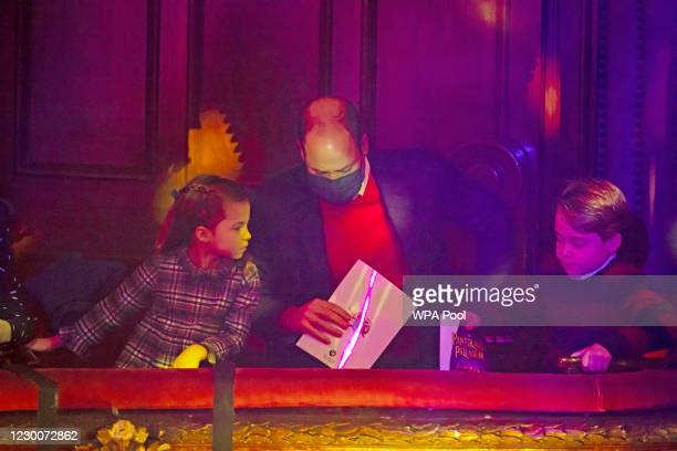 Prince William, Duke of Cambridge, Princess Charlotte and Prince George attend a special pantomime performance at London's Palladium Theatre, hosted...