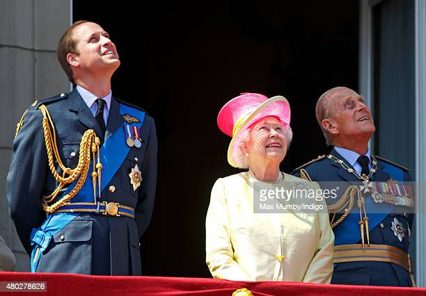 Prince William Duke of Cambridge Queen Elizabeth II and Prince Philip Duke of Edinburgh watch a flypast of Spitfire Hurricane aircraft from the...