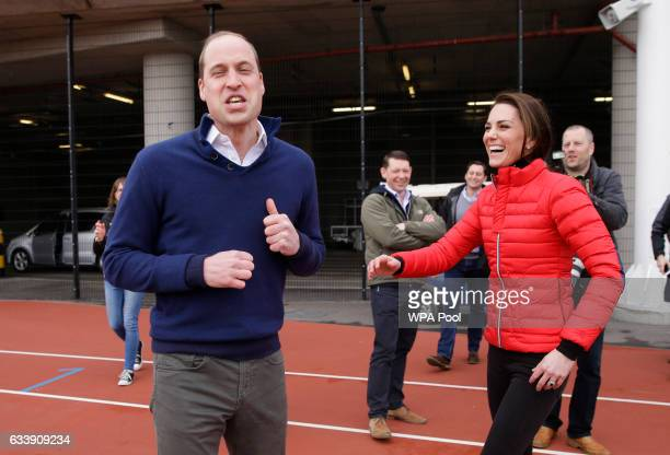 Prince William Duke of Cambridge reacts with Catherine Duchess of Cambridge after taking part in a race during a Marathon Training Day with Team...