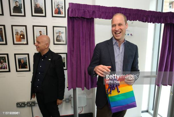 Prince William Duke of Cambridge receives a gift bag from trust chief executive officer Tim Sigsworth as he visits the Albert Kennedy Trust to learn...