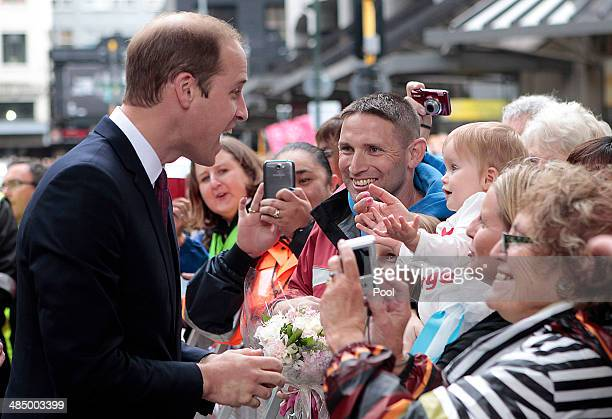 Prince William Duke of Cambridge receives gifts and shakes hands with the public during a walk about in Civic Square on April 16 2014 in Wellington...