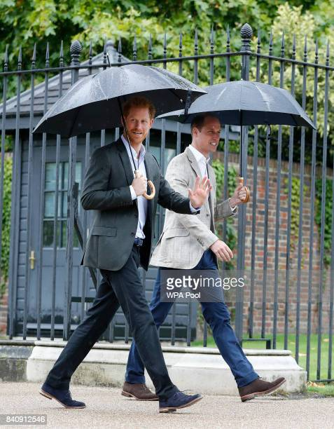 Prince William, Duke of Cambridge, right, and Prince Harry walk away after attending an event at the memorial garden int Kensington Palace on August...