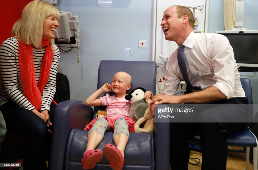Prince William, Duke of Cambridge, right, meets patient Daisy Wood, 6, and her mother Katie during a visit to the Royal Marsden hospital on May 16, 2017 in Sutton, England. The Duke of Cambridge, President of the Royal Marsden NHS Foundation Trust, visited the hospital's facilities in Sutton. During the visit, which marks 10 years since His Royal Highness became President of the centre, The Duke accompanied staff as they went about their daily activities in treating and caring for patients.