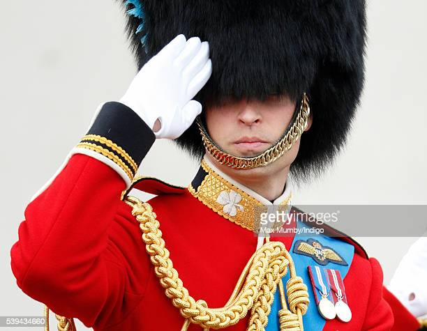 Prince William, Duke of Cambridge salutes as he attends Trooping the Colour, this year marking the Queen's 90th birthday on June 11, 2016 in London,...