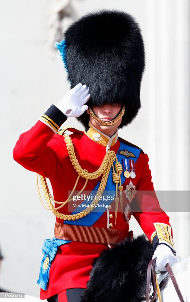 Prince William, Duke of Cambridge salutes as he leaves Buckingham Palace on horseback during the annual Trooping the Colour Ceremony on June 15, 2013 in London, England. Today's ceremony which marks the Queen's official birthday will not be attended by Prince Philip the Duke of Edinburgh as he recuperates from abdominal surgery. This will also be The Duchess of Cambridge's last public engagement before her baby is due to be born next month.
