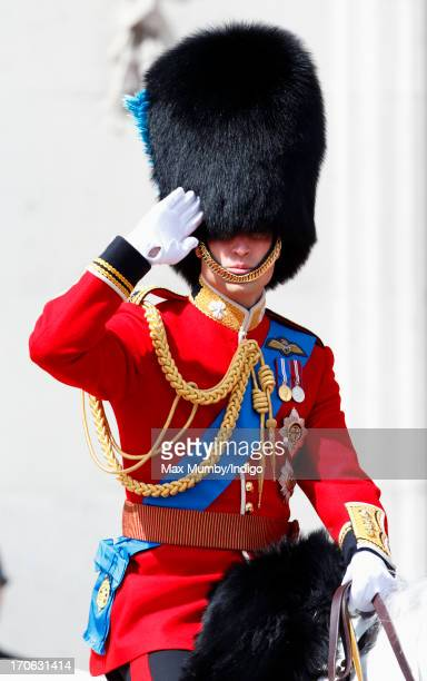 Prince William, Duke of Cambridge salutes as he leaves Buckingham Palace on horseback during the annual Trooping the Colour Ceremony on June 15, 2013...