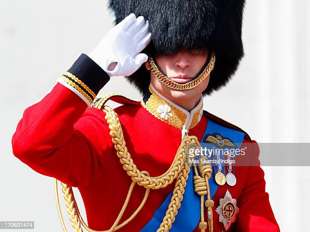 Prince William Duke of Cambridge salutes as he leaves Buckingham Palace on horseback during the annual Trooping the Colour Ceremony on June 15 2013...