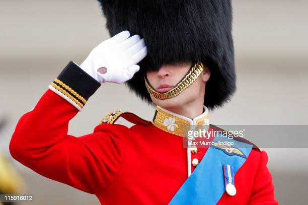 Prince William Duke of Cambridge salutes as he rides his horse in the Trooping the Colour parade on June 11 2011 in London England The ceremony of...