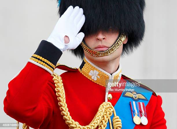 Prince William Duke of Cambridge salutes as he rides on horseback down The Mall during Trooping the Colour Queen Elizabeth II's Birthday Parade on...