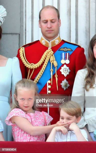 Prince William Duke of Cambridge Savannah Phillips and Prince George of Cambridge watch the flypast on the balcony of Buckingham Palace during...