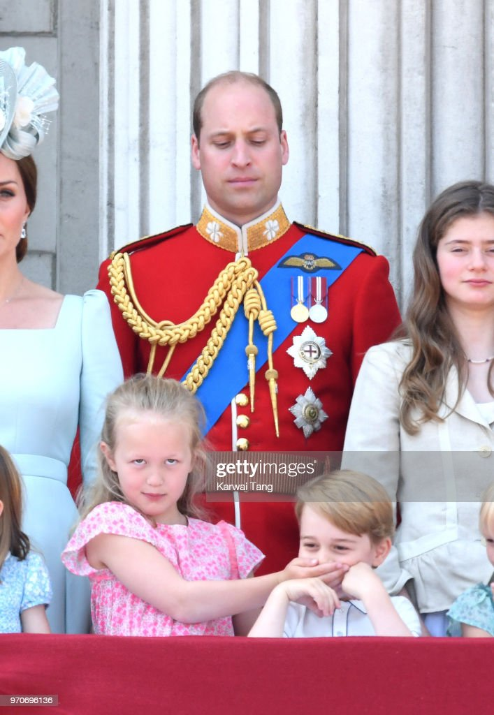 Prince William, Duke of Cambridge, Savannah Phillips and Prince George of Cambridge on the balcony of Buckingham Palace during Trooping The Colour 2018 at The Mall on June 9, 2018 in London, England. The annual ceremony involving over 1400 guardsmen and cavalry, is believed to have first been performed during the reign of King Charles II. The parade marks the official birthday of the Sovereign, even though the Queen's actual birthday is on April 21st.