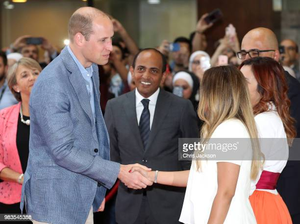 Prince William Duke of Cambridge shakes hands as he visits vocational training college Al Quds which has links to Middlesex University during his...
