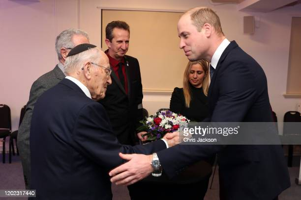 Prince William Duke of Cambridge shakes hands with Manfred Goldberg at the UK Holocaust Memorial Day Commemorative Ceremony in Westminster on January...