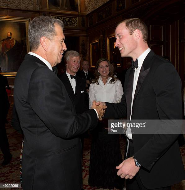 Prince William Duke of Cambridge shakes hands with Mario Testino at a dinner to celebrate the work of The Royal Marsden hosted by the Duke of...