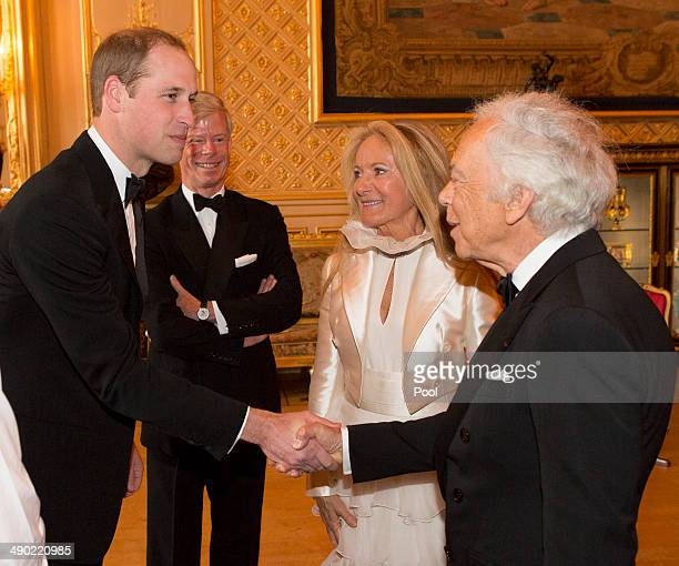Prince William Duke of Cambridge shakes hands with Ralph Lauren at a dinner to celebrate the work of The Royal Marsden hosted by the Duke of...