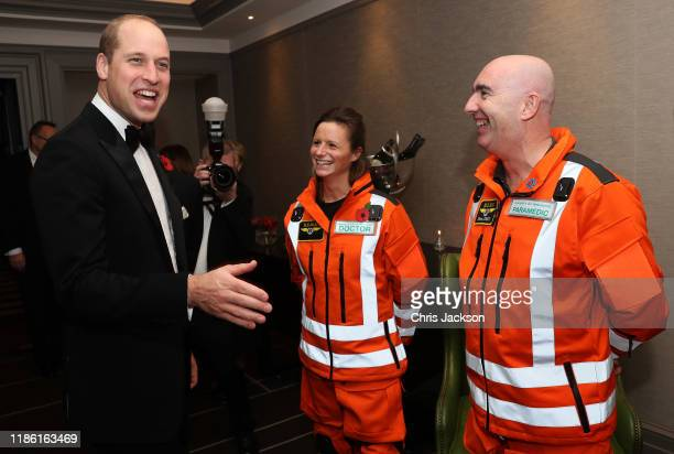 Prince William, Duke of Cambridge shares a joke with Doctor Flora Bird, Consultant in emergency medicine at the Royal London Hospital and Paramedic...