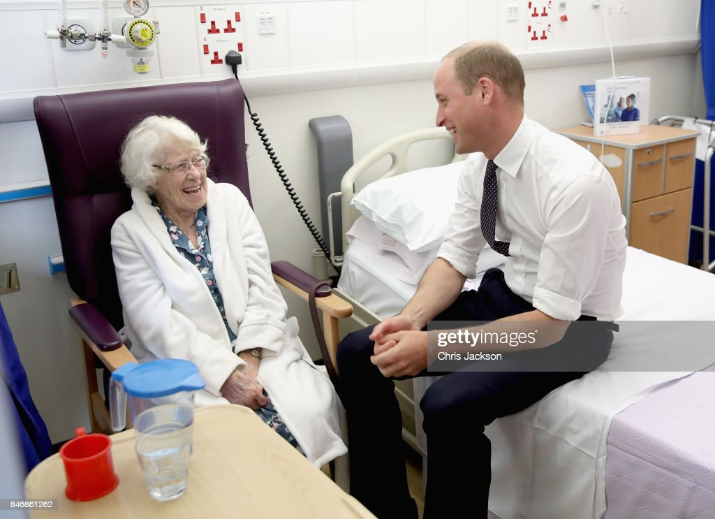 Prince William, Duke of Cambridge shares a joke with patient Theresa Jones in the Frailty unit during a visit to Aintree University Hospital on September 14, 2017 in Liverpool, England. The Duke visited Aintree University Hospital to formally open the new Urgent Care and Trauma Centre (UCAT). This new unit, serving a catchment area of 2.3m residents in the North West, opened in January 2017 following a £35m redevelopment.