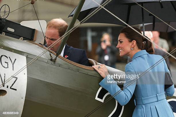 Prince William, Duke of Cambridge sits in a WW1 aircraft as Catherine, Duchess of Cambridge looks on during a visit to Omaka Aviation Heritage Centre...