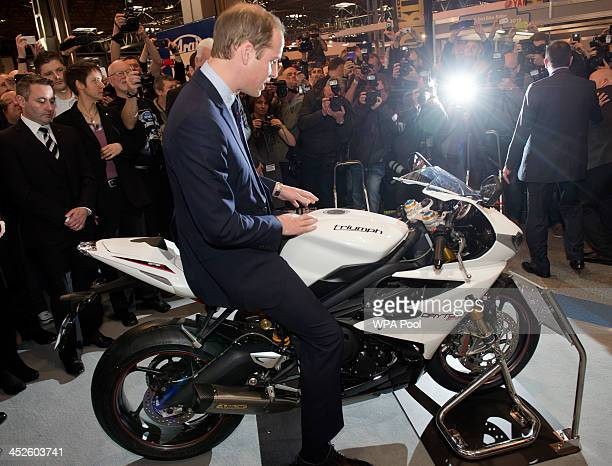 Prince William, Duke of Cambridge sits on a Triumph Daytona during a visit to Motorcycle Live at the National Exhibition Centre, where he toured the...