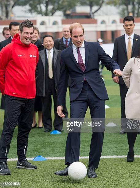 Prince William Duke of Cambridge smiles as he attends a Premier Skills Football Event on March 3 2015 in Shanghai China Prince William Duke of...