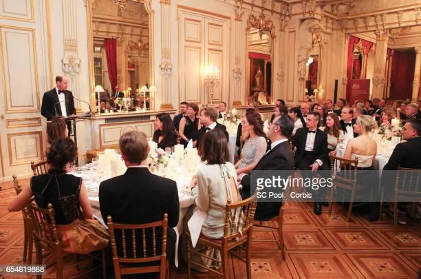 Prince William Duke of Cambridge speaks as Kristin Scott Thomas UK ambassador to France Edward Llewellyn and wife Anne Llewellyn Anne Hidalgo...