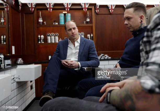 Prince William Duke of Cambridge speaks to Dean Hamilton as he visits Pall Mall Barbers on February 14 2018 in London England The Duke of Cambridge...