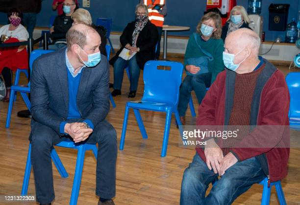 Prince William, Duke of Cambridge speaks to Geoff Smyth who was waiting to be vaccinated as he visits King's Lynn Corn Exchange Vaccination Centre on...
