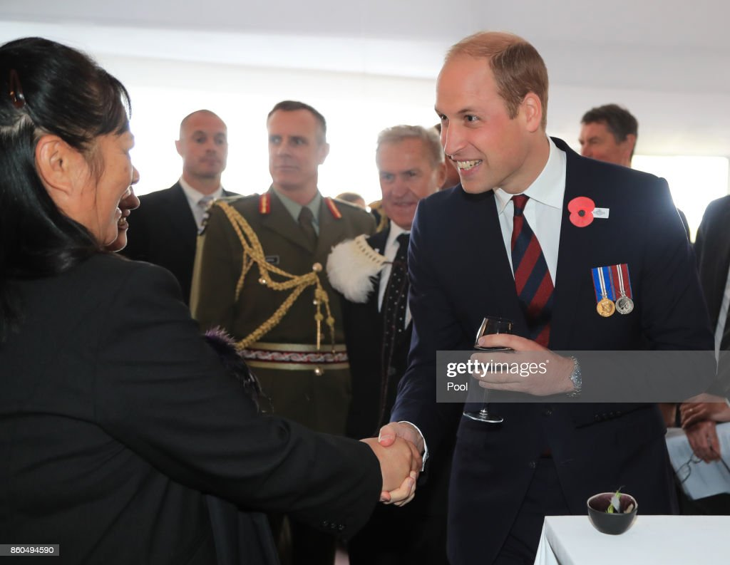 Prince William, Duke of Cambridge speaks to guests as he attends a reception for the Battle of Passchendaele at Tyne Cot Cemetery on October 12, 2017 in Flanders, Belgium.