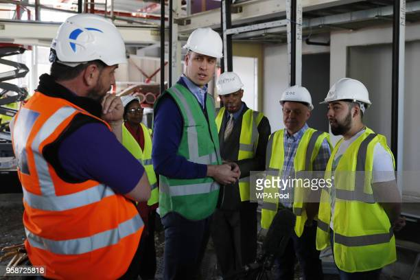 Prince William Duke of Cambridge speaks to Jason Garcia whose cousin Jessica perished in the fire and presenter Nick Knowles as he joins the crew of...