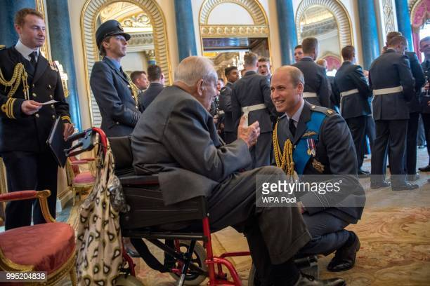Prince William Duke of Cambridge speaks to Jock Heatherill wing commander of 158th squadron Halifax's during a reception to mark the centenary of the...