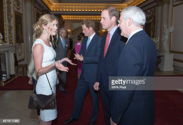 Prince William, Duke of Cambridge speaks to Joss Stone as Former British Prime Minister John Major looks on during the launch of The Queen's Young...