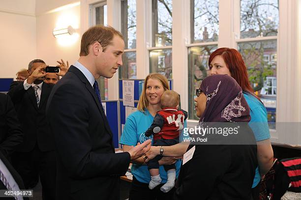 Prince William Duke of Cambridge speaks to Mashkura Begum of the Birmingham Leadership Foundation during his visit to South and City College on...