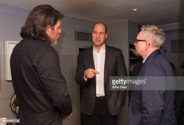 Prince William Duke of Cambridge speaks to meets Chair of CALM James Scroggs and CALM CEO Simon Gunning during a visit to meet staff volunteers and...