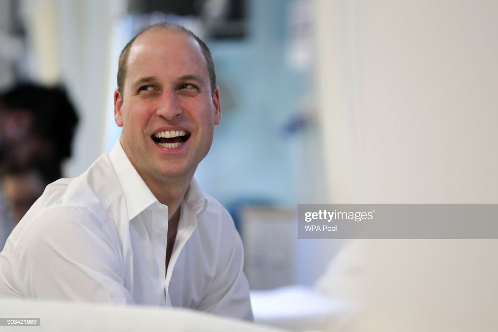 Prince William, Duke of Cambridge speaks to patient Paul Tester (not seen) during his visit to The Royal Marsden Hospital on January 10, 2018 in London, England. Prince William was visiting the hospital to view two pioneering robotic surgeries.