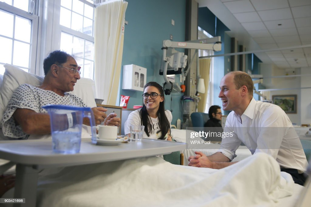 Prince William, Duke of Cambridge speaks to patient Vusof Omar (L) during his visit to The Royal Marsden Hospital on January 10, 2018 in London, England. Prince William was visiting the hospital to view two pioneering robotic surgeries.