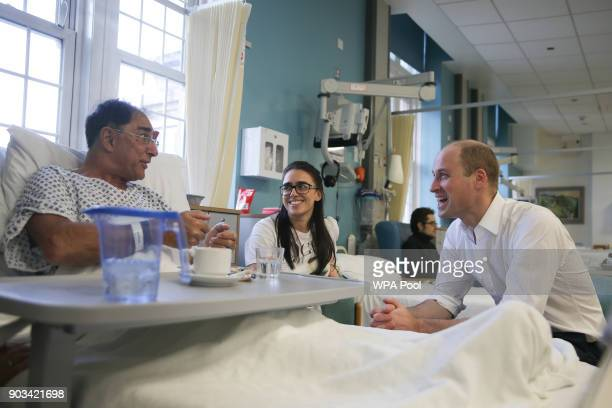 Prince William Duke of Cambridge speaks to patient Vusof Omar during his visit to The Royal Marsden Hospital on January 10 2018 in London England...