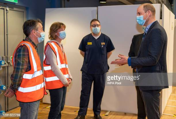 Prince William, Duke of Cambridge speaks to RVS volunteers husband and wife Fliss and Stuart Davidson from Downham market as he visits King's Lynn...