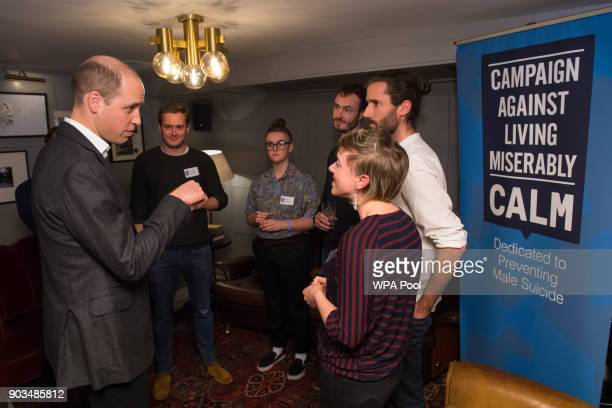 Prince William Duke of Cambridge speaks to volunteers of 'Campaign Against Living Miserably' a charity dedicated to preventing male suicide to lend...