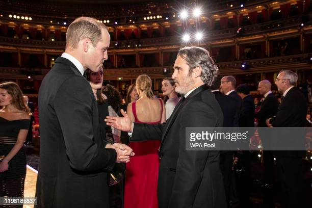 Prince William Duke of Cambridge speaks with BAFTA winner Joaquin Phoenix at the EE British Academy Film Awards 2020 at Royal Albert Hall on February...