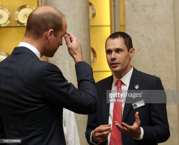 Prince William Duke of Cambridge speaks with diver Chris Jewell during a reception to recognise the extraordinary contribution made by British rescue...