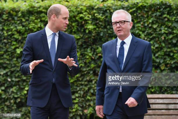 Prince William Duke of Cambridge speaks with Ian Austin MP before unveiling a new sculpture of Major Frank Foley by artist Andy de Comyn on September...