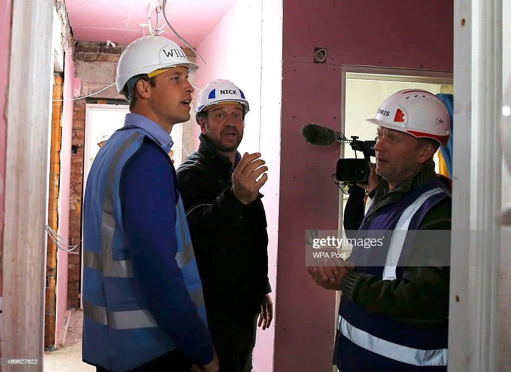Prince William, Duke of Cambridge speaks with presenter Nick Knowles (C) as he helps to renovate homes for ex-service personnel as part of the BBC television DIY SOS series on September 23, 2015 in Manchester, England. Prince William and Prince Harry visited Manchester on Wednesday where they helped to renovate homes for ex-service personnel as part of the BBC television DIY SOS series.