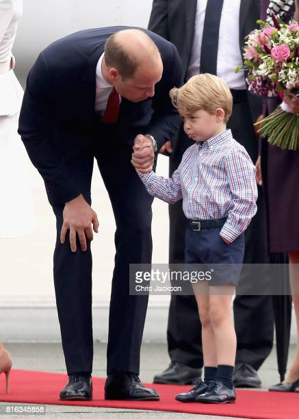 Prince William Duke of Cambridge speaks with Prince George of Cambridge as they arrive with Catherine Duchess of Cambridge and Princess Charlotte of...