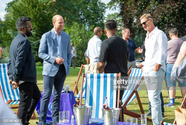 Prince William Duke of Cambridge speaks with Ronesh Ranganathan and former Arsenal player Tony Adams as he hosts an outdoor screening of the Heads Up...