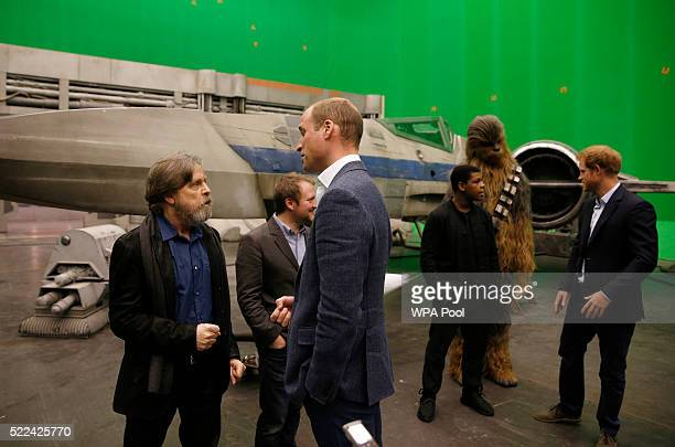Prince William Duke of Cambridge speaks with US actor Mark Hamill as Prince Harry speaks with British actor John Boyega during a tour of the Star...